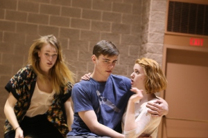 Sonder cast rehearses family scene.  Erin Pettifor as the mother comforts her children (Julia Van Dam, Evan Macleod).