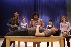 Sonder cast creates funeral vignette.  Evan Macleod as Doug the deceased.  Mourners left to right: Julia Van Dam, Emily Cupples, Tyler Johnson, Brittany Martyshuk.